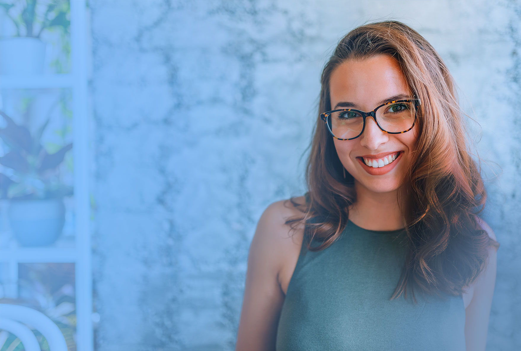 Woman wearing glasses smiles